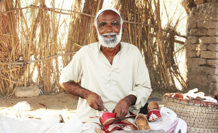 Abdul livelihood making khussa shoes was greatly impacted by the 2014 Pakistan floods