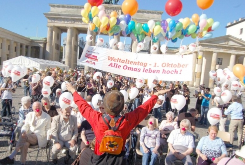 Age Demands Action campaigners in front of the Brandenburg Gate in Berlin.