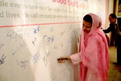 An ADA supporter in Pakistan signs the petition.
