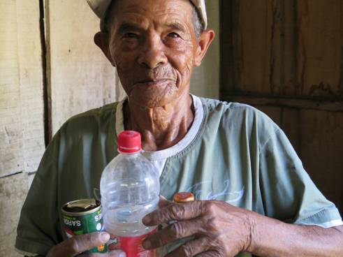 With the cash assistance we gave Apolinario, he bought materials to rebuild his home and restart his business.