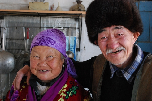 A couple from Kyrgyzstan smile and laugh