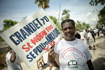 Older women protesting for her rights in Haiti