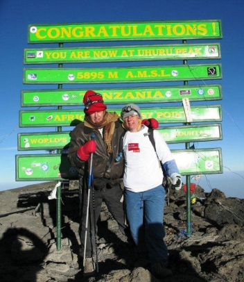 Irene and I (right) on top of Kilimanjaro!
