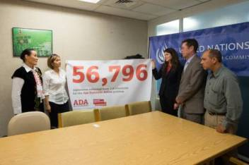 ADA activist, Kulumkan Shabdanbekova (extreme left) presents the ADA petition to Ivan Simonovic.