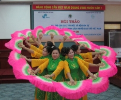 Members of an Older Persons Self-Help Group performa at ADA Vietnam