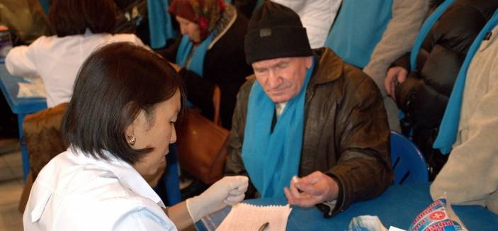 Older man in Kyrgyzstan has blood test for diabetes