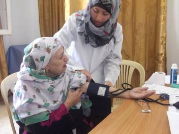 An older woman in Gaza gets her blood pressure checked at a mobile clinic for World Health Day 2012