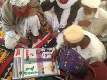 A game of DRR-themed Ludo. (c) HelpAge International