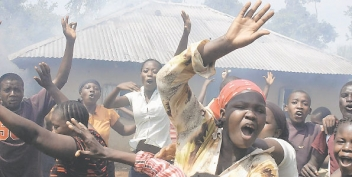 Residents of a village celebrate as the house of a suspected witch goes up in flames. Photo/FILE