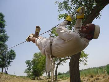 A man in Pakistan shows how to cross water via a wire