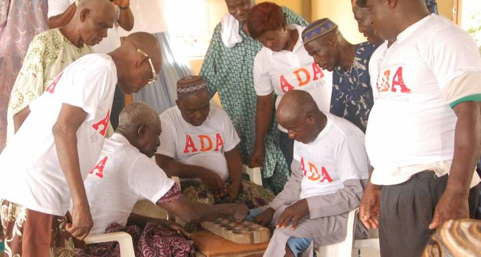 Older men play a game to help improve cognitive skills (c) Oluwole Oluwadamilola/Age Nigeria Foundation