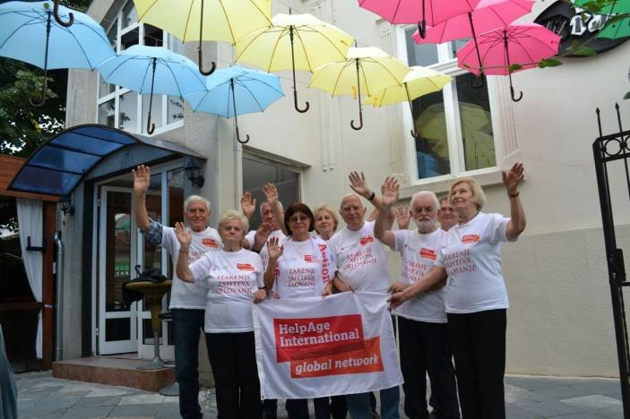 Serbia's older people organised their own photoshoot beneath hanging umbrellas (c) Volunteers of Red Cross Serbia