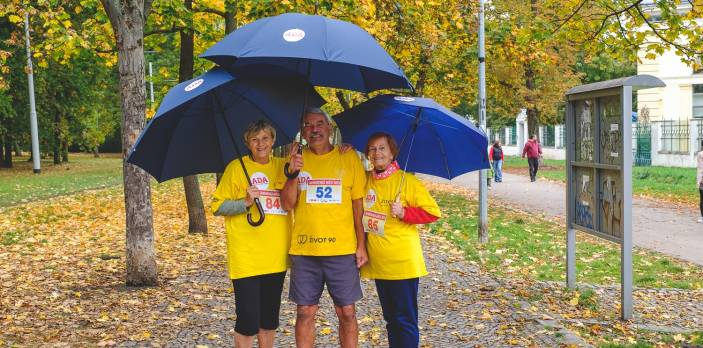 Older men and women hold umbrellas on their senior run in the Czech Republic (c) Jiri Starha/HelpAge International