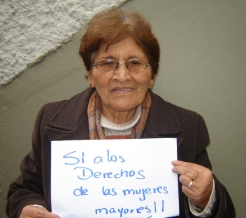 Isabel, 73, from Bolivia holds a sign saying 'Yes to older women's rights'