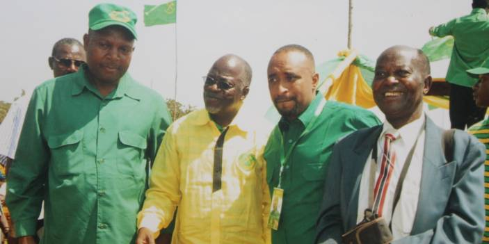 Mzee Clement Kwezi (far right) with Dr John Pombe Magufuli, President of Tanzania (in yellow)