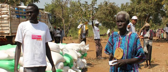 Nyadeng, 80, receives maize ration from HelpAge humanitarian staff (c) Erna Mentesnot Hintz/HelpAge International