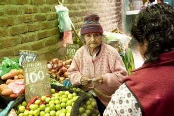 Juana Aronez de Mendes , 86, runs a small vegetable and fruit stall in Lima, Peru.