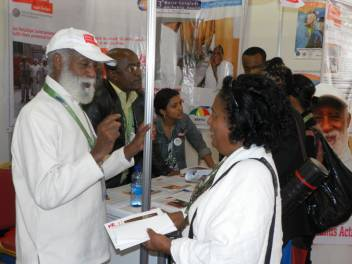 ADA leader, Tilahun Abebe speaks to a visitor at the conference.