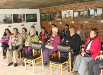 Older people enjoy the photo exhibition