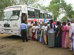 Older people waiting outside the Mobile Medical Unit.