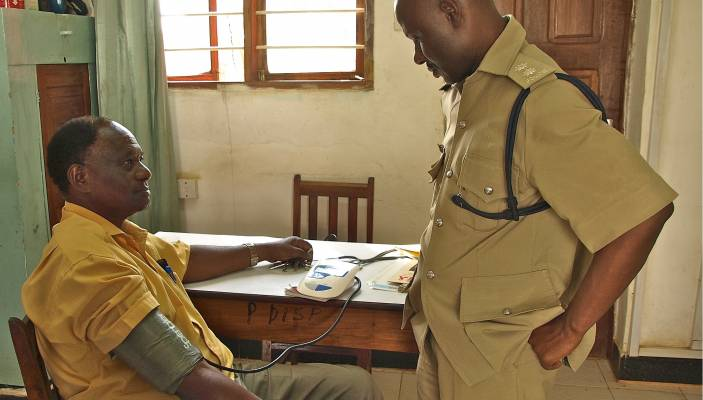 Older man in Tanzania has blood pressure taken (c) Paul Ong/HelpAge International