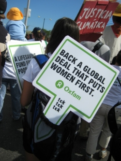 Civil society protesting in Cancun, wwww.tcktcktck.org