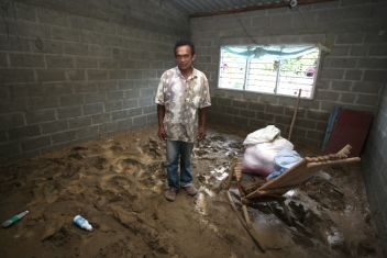 Eulogio in what remains of his flooded house