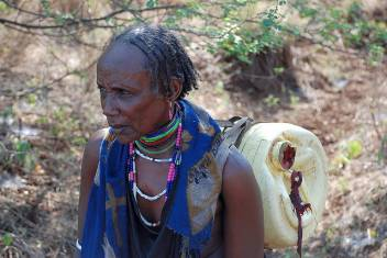 Teso, 63, from Ethiopia on her way to collect water for her family
