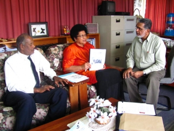 FCOSS representatives present MIPAA to the Fiji government