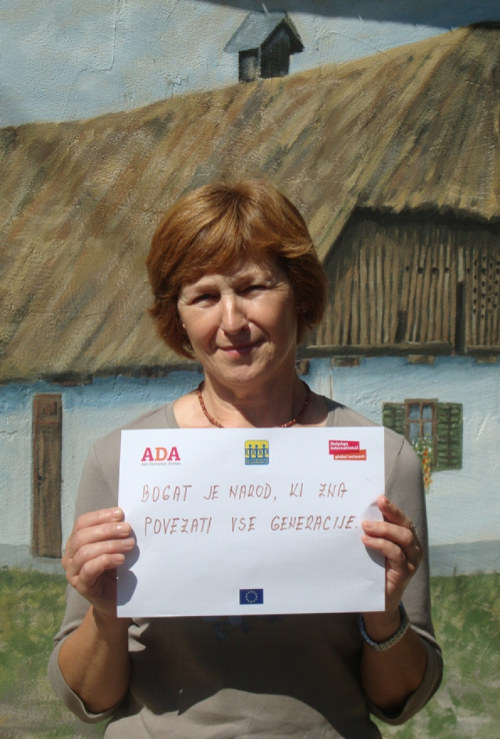 Slovenia ADA activist with sign 'A rich society includes all generations'