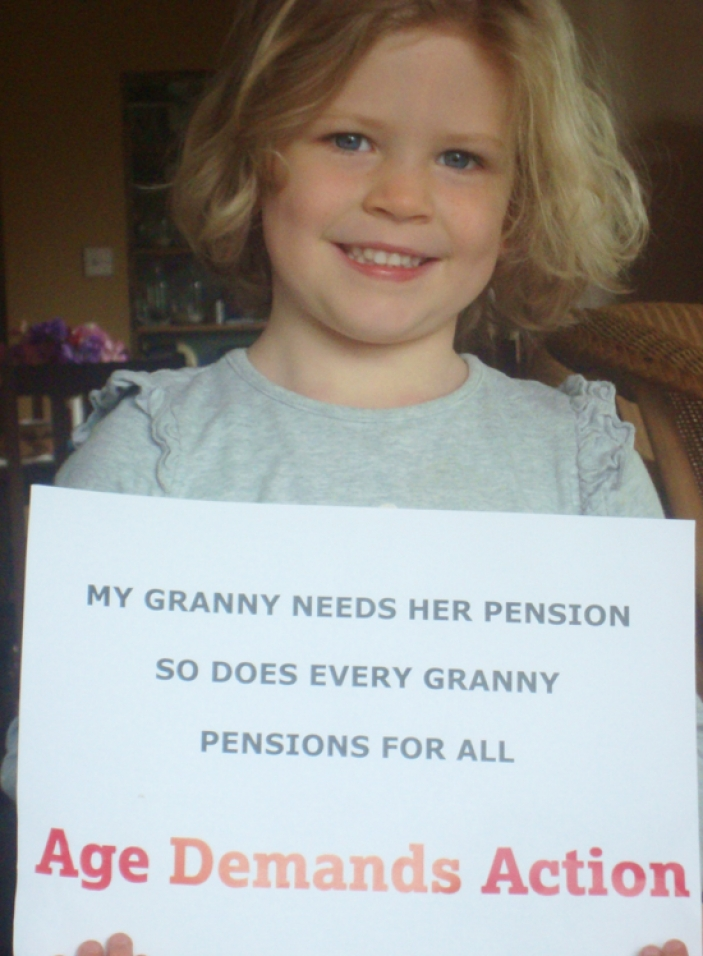 A young ADA activist from the UK holds a sign saying her granny deserves a pension