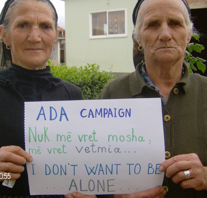 ADA Albania campaigners hold a sign saying 'I don't want to be alone'