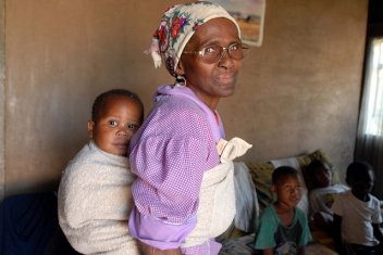 In South Africa, Nokwazi Radebe, 62, uses her pension and child support grant to care for her seven orphaned grandchildren and HIV positive son.