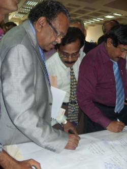 Dr Ruhul Haque, Minister of Health in Bangladesh, signs the ADA petition