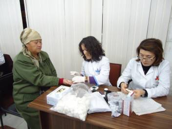 An older woman takes part in a diabetes screening in Kyrgyzstan.