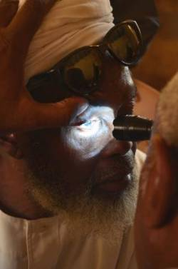 An older man gets his eyes tested in Sudan. (c) HelpAge International