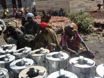 Older people wait to receive their briquettes and stoves. (c) Mireine Bulonza/HelpAge International