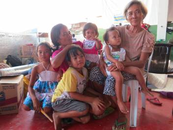 Marie Selina with her family in the evacuation centre. (c) Rosaleen Cunningham/HelpAge International