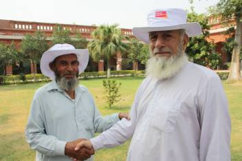 Members of older people's associations greet each other in Nowshera (c) SM Abdullah/HelpAge International