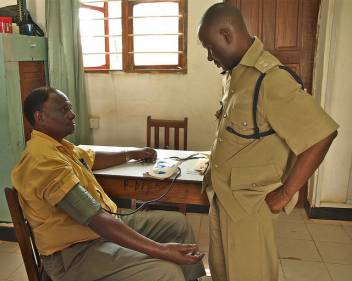 An older man has his blood pressure checked in Tanzania. (c) Paul Ong/HelpAge International