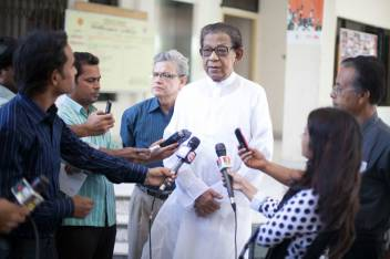 Minister of Social Welfare talks to journalists on 1 October. (c) HelpAge