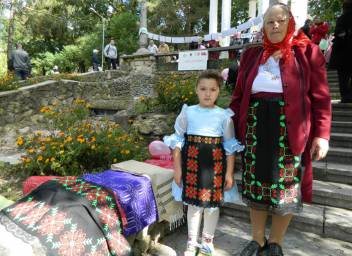Older woman and girl in Moldova at a HelpAge event. (c) HelpAge International