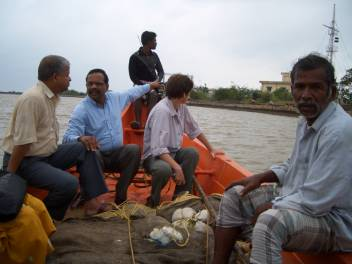 Goddy Paul, with partner HelpAge India, on a fishing boat donated by HelpAge International