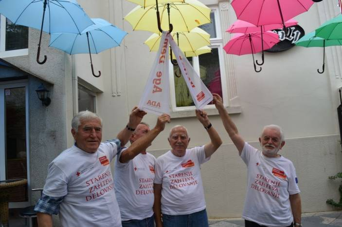 Serbia's Age Demands Action campaigners raise their umbrellas to a world without ageism