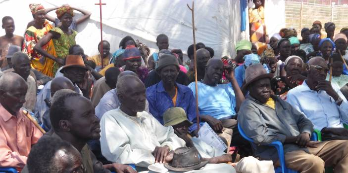 Older people gather for a meeting in Numanzi refugee camp