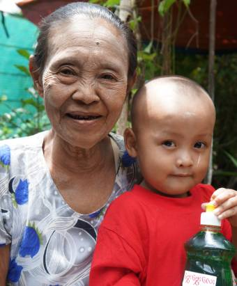 Daw Khin Than with one of her grandchildren.