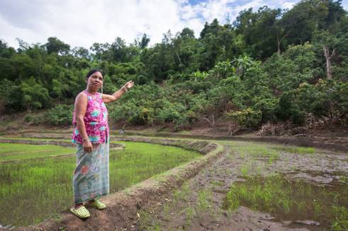 Nalor from Thailand points out how landslides that may come from the hillside, pose a threat to her paddy fields.