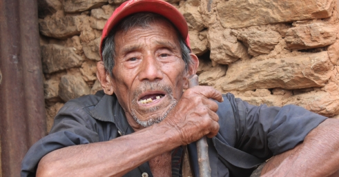 Dupha in front of his home in Nepal (c) Judith Escribano/Age International