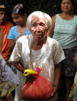 An older woman in the Philippines after typhoon Ketsana, October 2009.