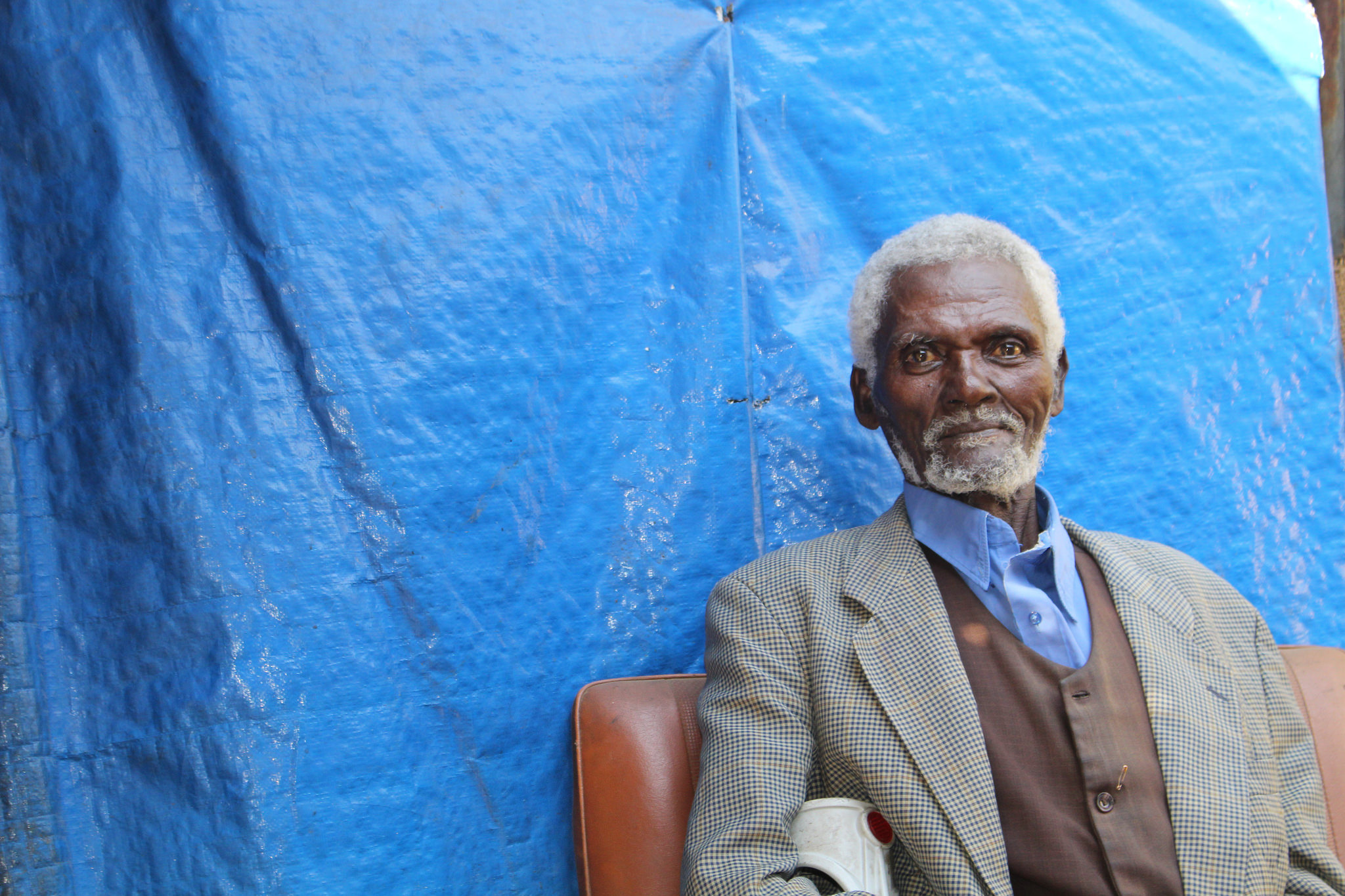 Fikru, a former long-distance driver from Ethiopia, receives daily visits from a volunteer home carer through Tesfa Social and Development Association (c) Lydia Humphrey/Age International
